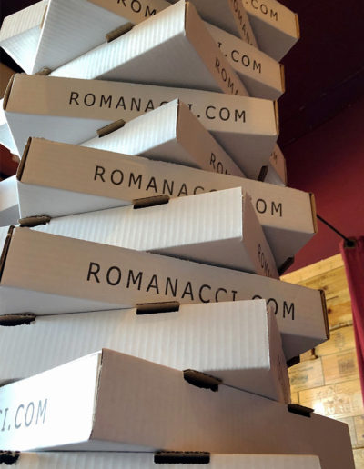 A tall stack of Romanacci pizza boxes at Norwalk Hospital