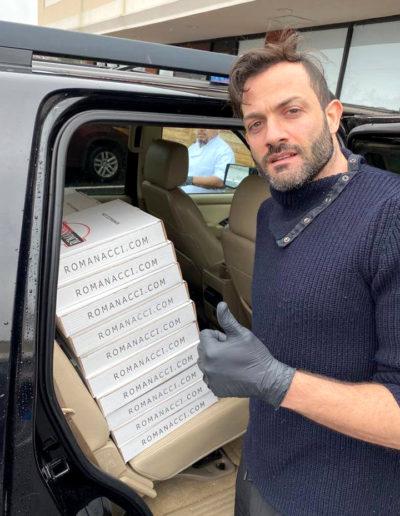 Maurizio Ricci, owner of Romanacci Pizza, loads pizzas into car